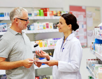 a pharmacist recommending some medicine to the customer