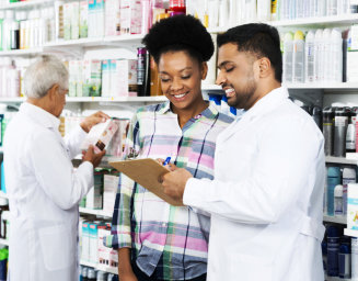 a pharmacist chatting with a customer