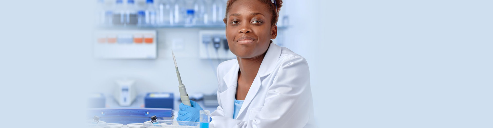 a pharmacist smiling at the camera
